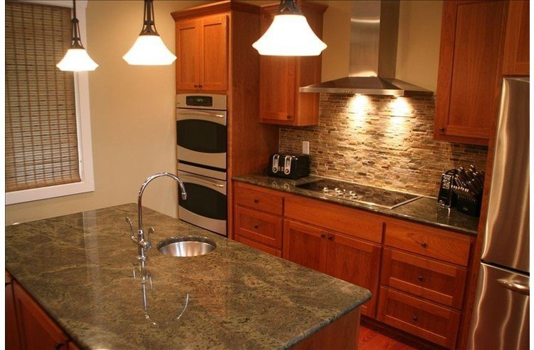 Fully equipped kitchen with stainless steel appliances and two ovens